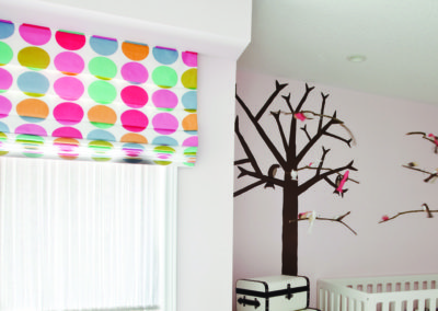 Modern baby nursery with polka dots and trees
